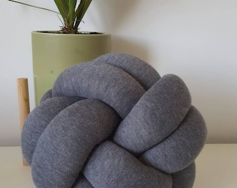 Soft grey knot pillows