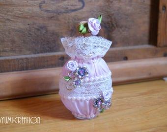 Small purple glass bottle