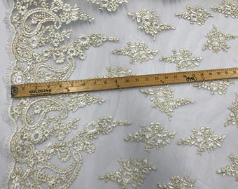 Ivory paisly flower enbroider and corded with metallic gold tread on a mesh lace-wedding-bridal-prom-nightgown-sold by the yard.