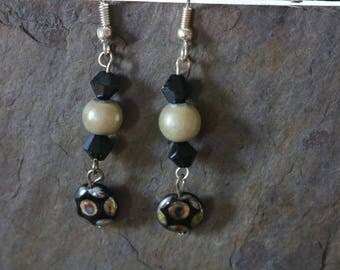Black and white pearl accent earrings