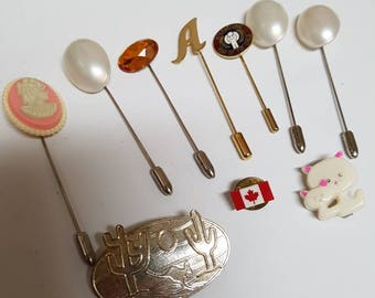 10 pieces of pins or brooches. Hat pins. Lapel pins