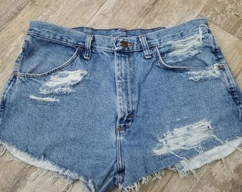 High waisted, distressed festival shorts. rustler brand