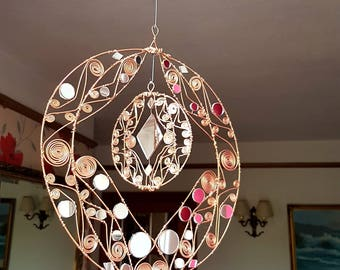 Wire sculpted circular mirrored Sun Catcher
