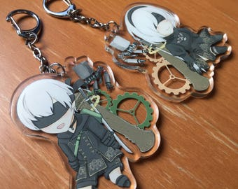 NieR: Automata Charms (7x7cm, double-sided clear acrylic) featuring 2B and 9S