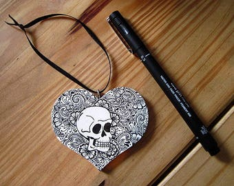Wooden Heart Ornament with Black Skull Pattern on Full Background