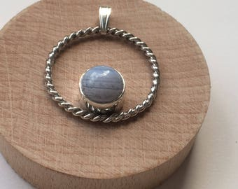 Circle pendant with a white translucent agate