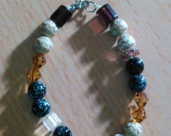 White, black, brown, and glass bead bracelet