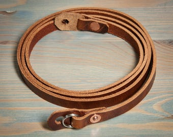 Hand made leather camera strap. Chestnut with copper rivets.