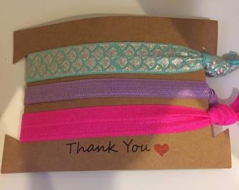 Pre packaged shimmery mermaid hair ties