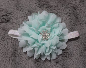 flower with snowflakes jewel on a white glitter headband