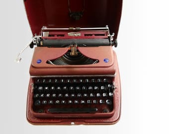 Typewriter triumph perfectly with suitcase - ca 1950; typewriter triumph of perfectly with case - 1950