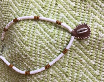 Beaded Necklace With Leather Enclosed Shell