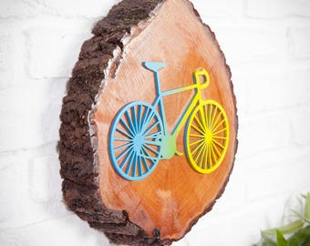 Slice of trunk with embossed wooden bicycle