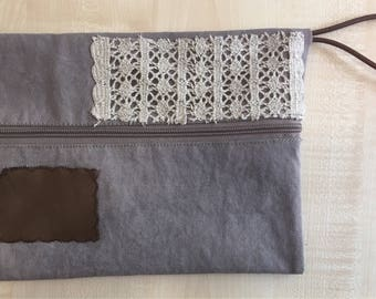 Handmade canvas zippered clutch with leather details