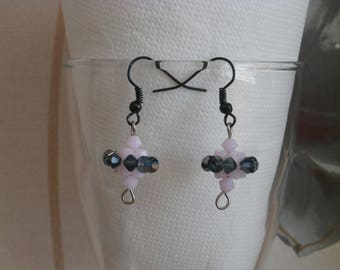 """Earrings """"Spinning"""" pink and black transparent."""