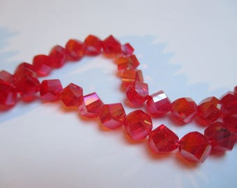 10 faceted red AB Crystal 6 x 5 mm