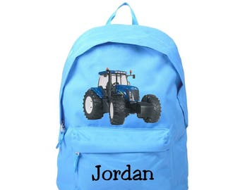 bag has blue tractor personalized with name