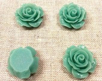 Set of 4 T 5 light green color flower cabochons