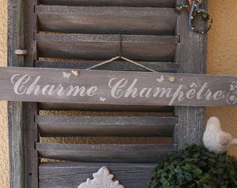 "Decorative sign in weathered wood ""Country charm"""