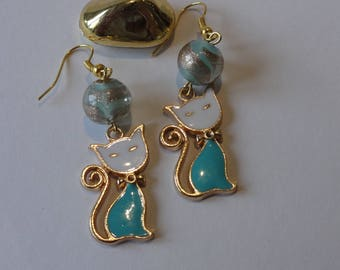 White, green and gold cat earrings