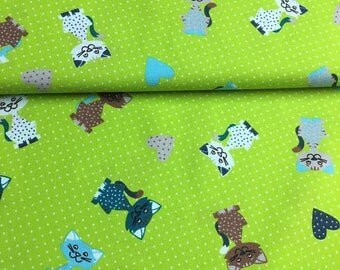 Cats, green-colored 100% cotton fabric