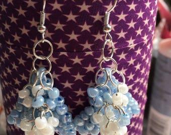Beaded blue and white beads dangling earrings