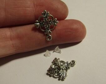 pair of silver stud earrings 20mmx16mm