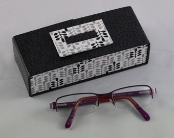 Cardboard covered with black faux leather glasses case