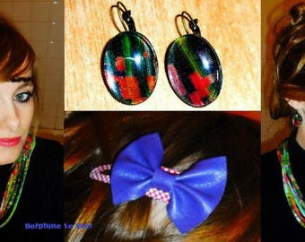Hair bow pin with faux purple clip.