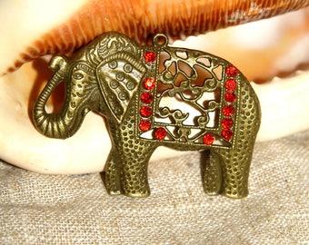 All bronze elephant pendant and rhinestones approx: 53 X 57 MM