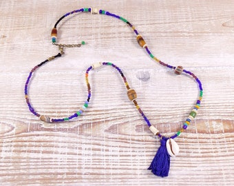 Long necklace, shell cowrie, tassel, African and seed beads, shades of blue.