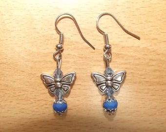 Blue earrings with a butterfly charm.