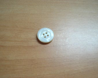 set of seven Pearl used buttons
