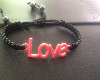 Black bracelet with symbol love neon pink/red