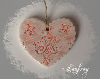 Heart made of earthenware, has red Monogram lace print
