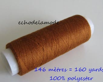 Spool of thread sewing caramel brown 146 m 100% polyester