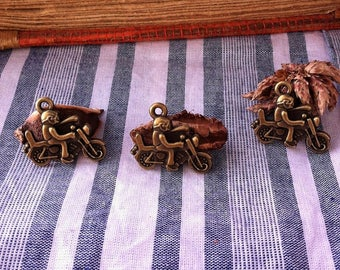 4 pendants with headphones on bronze motorcycle biker size 22 x 19 mm