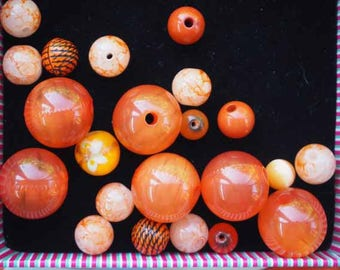 Set of 22 different styles, oval, round, different shades glass beads orange