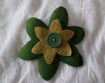 made with two flowers and a button pin