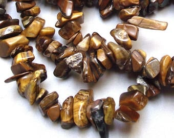 100 beads 6/10 mm Tiger eye stone chips.