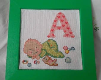 "Wood frame with baby ""A"" embroidered alphabet"