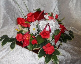 composition in red and white flowers set for wedding