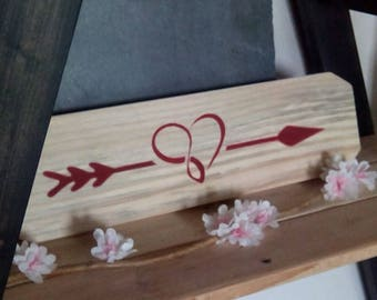 Cupid's arrow on a wood pallet Board