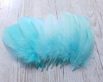 Set of 10 green water down feathers
