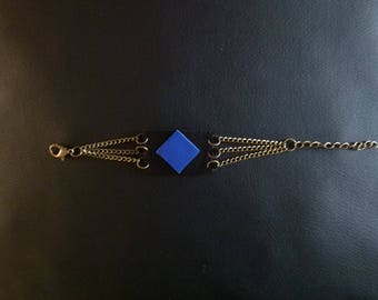 Blue and black leather strap and brass chain