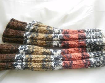Knitted mittens handmade in a yarn changing in different shades of Tan, Brown, beige and orange