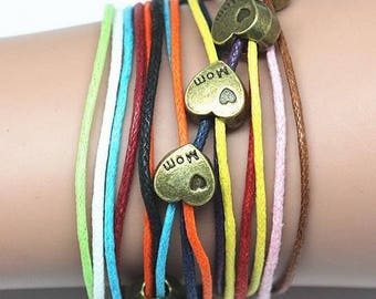 Bracelet multi strand with colorful cords and metallic hearts