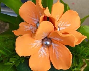 Flat orange hibiscus flower clip