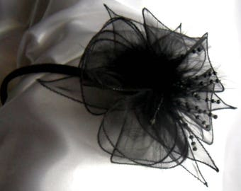 Decorated with black flower headband with feathers and beads