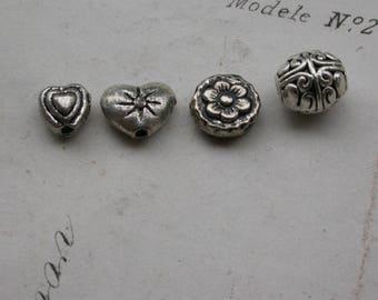 set of 14 silver heart flower beads